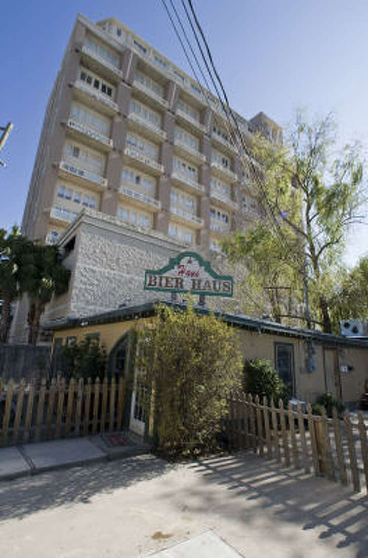Hans' Bier Haus near Rice Village is situated next door to high rise condominiums with an attached garage on Robinhood Drive.