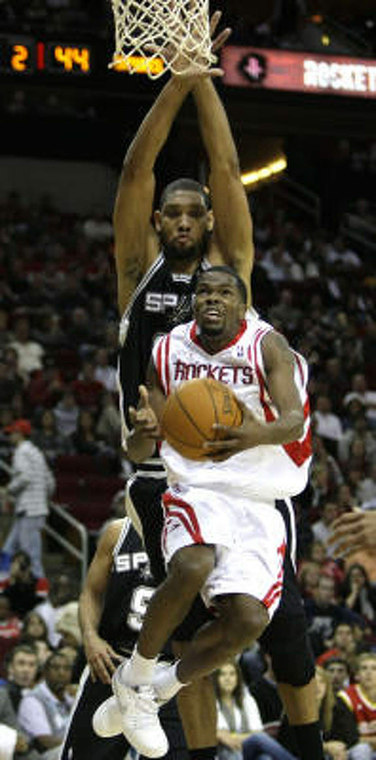 Rockets guard Aaron Brooks has become adept at taking on bigger players at the basket.