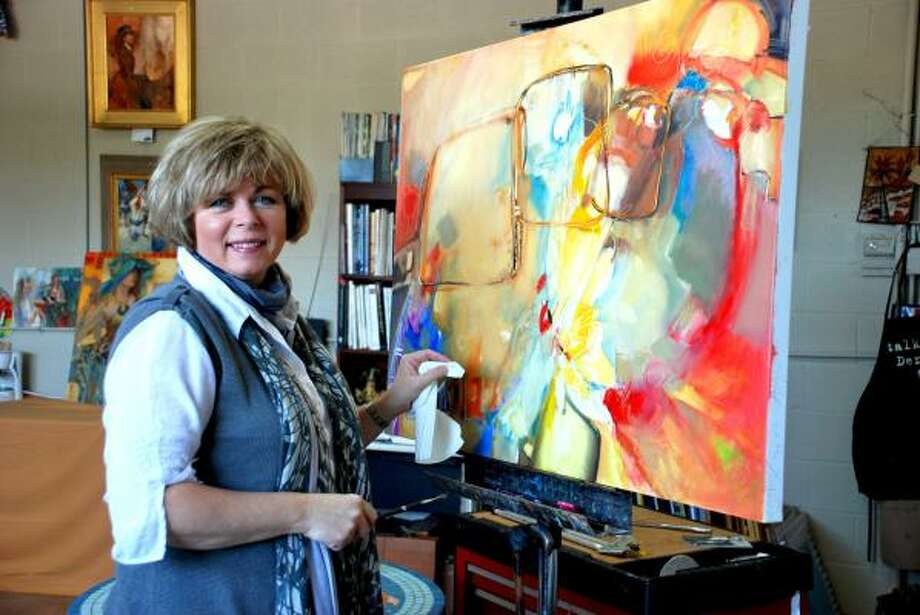 LINDSAY PEYTON: FOR THE CHRONICLE IN THE STUDIO: Lesley Humphrey paints in her studio located above a transformed auto parts shop in downtown Tomball. Humphrey is the official artist of the 2011 Kentucky Derby and Kentucky Oaks. Photo: ALL