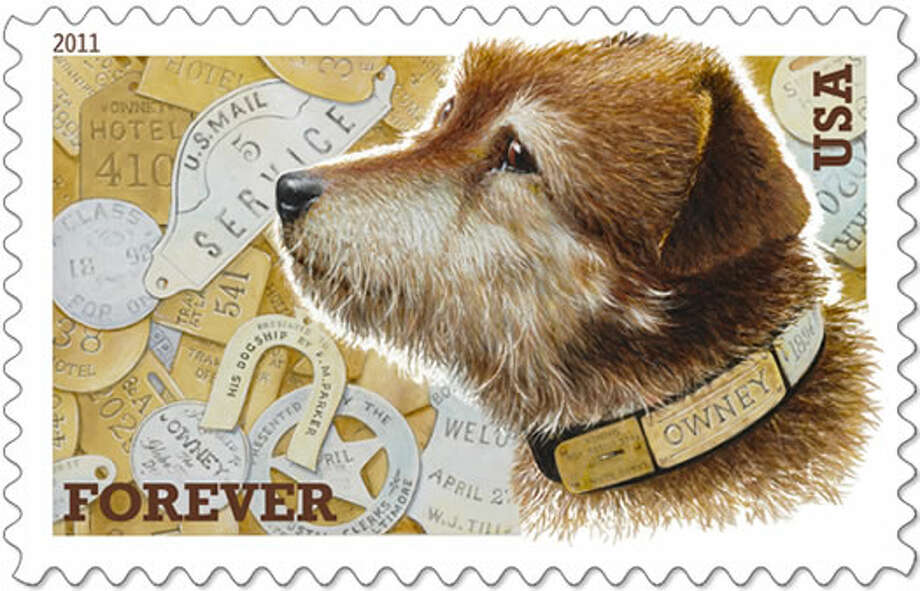 A stamp portraying Owney, a stray mutt that wandered into an Albany post office in 1888 and became the unofficial mascot of the Railway Mail Service. (US Postal Service)