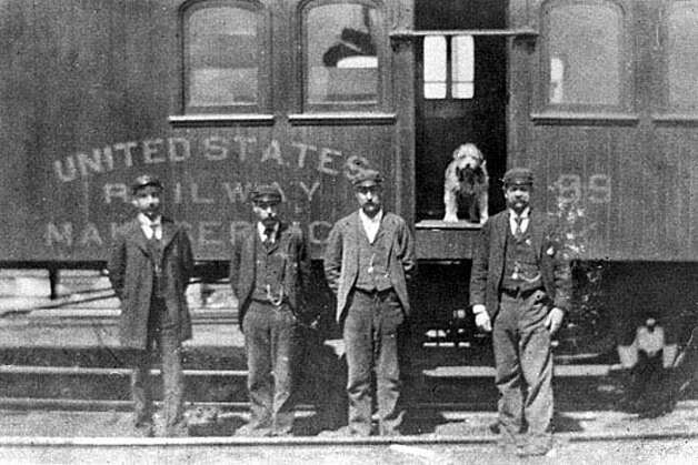 Owney, U.S. Railway Mail Service mascot, poses in a mail train with some of his friends. The legendary Irish terrier mix, adopted by Albany postal workers, gained international fame in the late-19th century and is the subject of a children's book and new postage stamp. (Courtesy National Postal Museum/Times Union archive)
