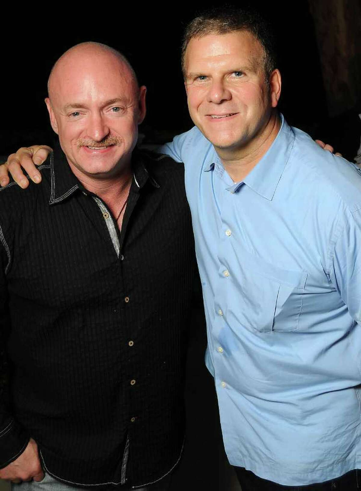Astronaut Mark Kelly and Tilman Fertitta at the Gathering of Champions benefitting Houston Children's Charity at Fertitta's home Wednesday April 13,2011.(Dave Rossman/For the Chronicle)