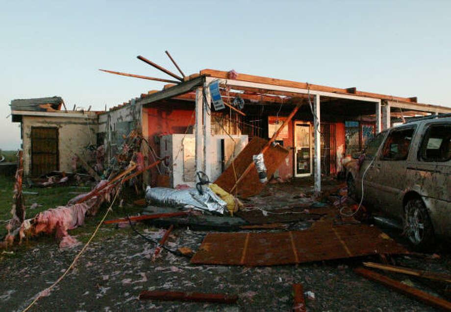 A market in the La Central neighborhood of Eagle Pass, Texas, lies in ruins at sunrise Wednesday. Photo: Theresa Scarbrough, AP