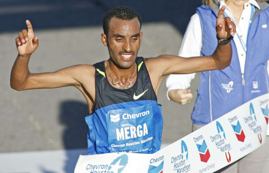 Deriba Merga of Ethiopia celebrates as he crosses the finish line in first place at the 2009 Houston Marathon on Sunday. Photo: Eric S. Swist, AP