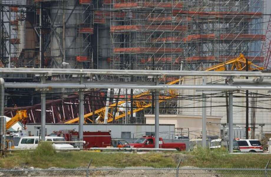 What appears to be a portion of a collapsed crane is visible within the LyondellBasell refinery on Friday in Houston. Photo: Steve Ueckert, Chronicle