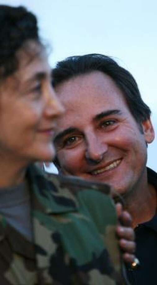 "Juan Carlos Lecompte, seen celebrating the return of his wife, Ingrid Betancourt, foreground, now says he and his wife's relationship is troubled. ""Her love for me may have ended in the jungle,"" Lecompte said. Photo: Scott Dalton, For The Chronicle"