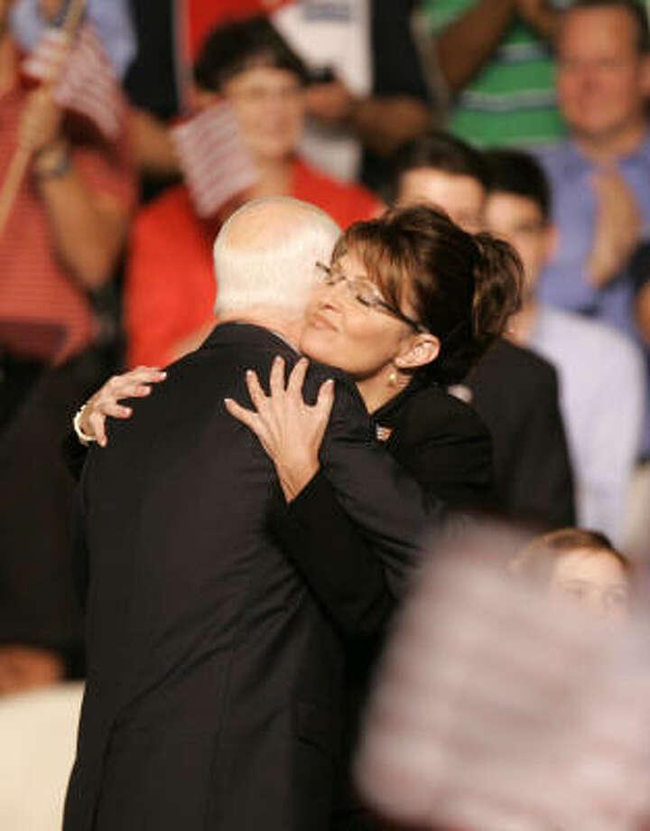 Republican presidential candidate Sen. John McCain hugs Alaska Gov. Sarah Palin as McCain announces her as his vice presidential running mate Friday. Photo: Kiichiro Sato, AP