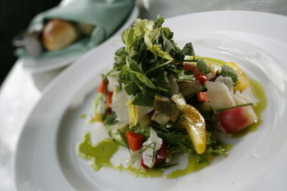 Reef restaurant's Market salad, served here with bread, adds flair to any meal. Photo: Kevin Fujii, Chronicle