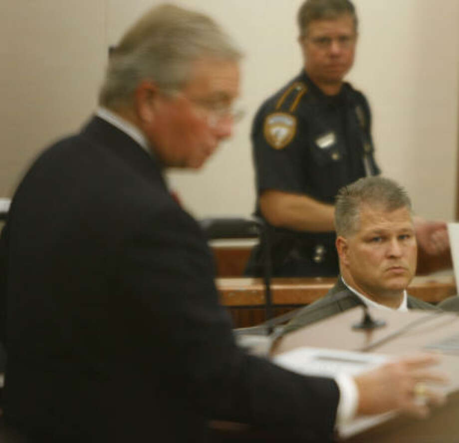 Defense attorney Dick DeGuerin, left, shown at the trial Tuesday with client David Temple, said the former football coach was at a grocery store when Temple's wife, Belinda, was shot to death. Photo: Kevin Fujii, Chronicle