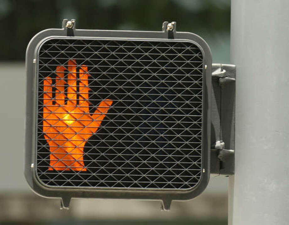 Vandals in Houston have changed crosswalk signs to give pedestrians the middle finger.Click through the slideshow to see other weird stuff spotted on Houston roads. Photo: MELISSA PHILLIP, HOUSTON CHRONICLE