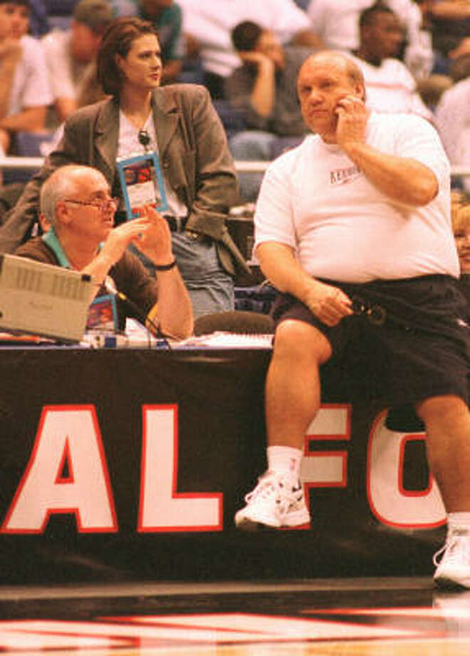 Billy Packer (with Rick Majerus) said he rarely talks about sports at home. Photo: Chronicle File
