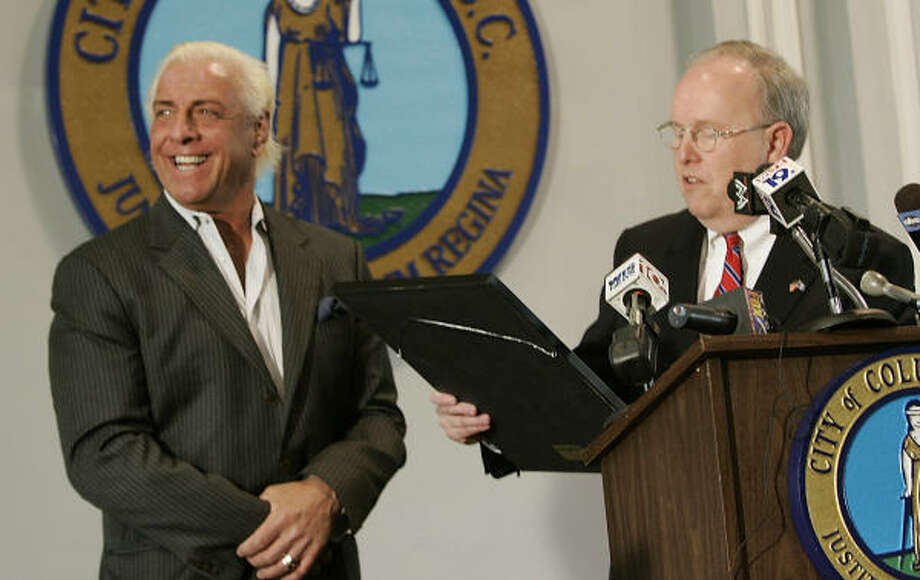 Professional wrestler Ric Flair, left, receives a key to the city from Columbia Mayor Bob Coble, right, as Flair is recognized for his career and community service accomplishments on Monday, March 24, 2008. Photo: Erik Campos, AP