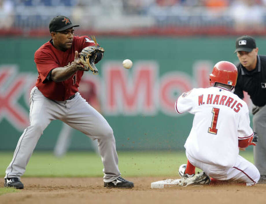 Nationals center fielder Willie Harris (1) slides into second safely with a double against the Houston Astros shortstop Miguel Tejada. Photo: Nick Wass, AP