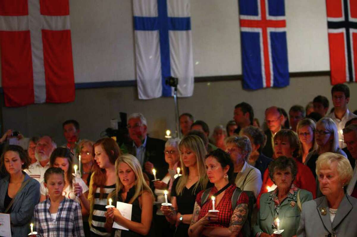 Hundreds of people pack a room during a vigil of remembrance at Seattle's Nordic Heritage Museum. Hundreds more gathered outside the packed vigil. Seattle's large Nordic population has been shaken by the violent attacks in Norway that killed 76 people, mostly children.