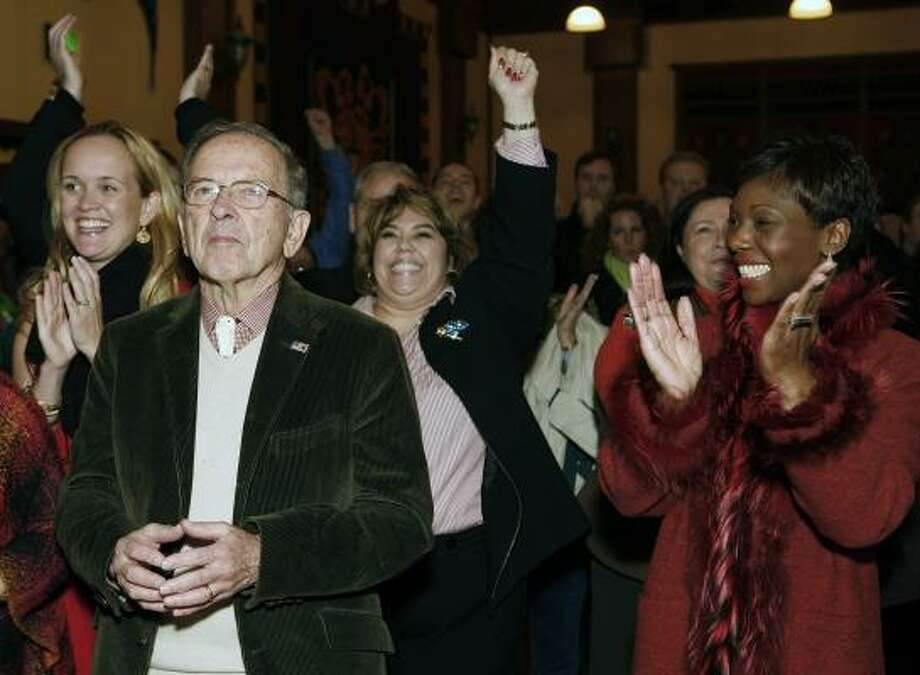 Sen. Ted Stevens, R-Alaska, watches election results Tuesday night as supporters cheer. The outcome of his re-election bid was still in doubt Wednesday. Photo: AL GRILLO, ASSOCIATED PRESS
