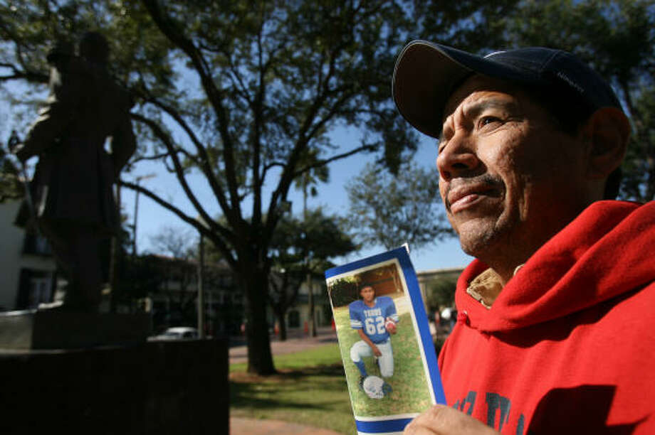 """Adrian Aviles holds a photo of his son, Jorge, last seen in April 2006. """"I still have hope that he's alive,"""" the Laredo man says. Photo: MAYRA BELTRÁN, Houston Chronicle"""