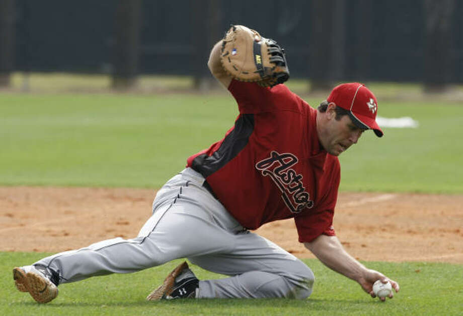 Lance Berkman described his left knee as cranky and sore. Photo: Julio Cortez, Chronicle
