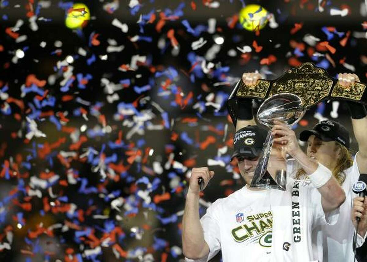 Packers stars Aaron Rodgers and Clay Matthews celebrate Green Bay's first Super Bowl win since 1997.
