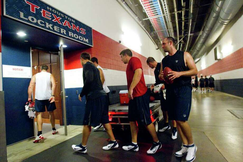 Houston Texans players walk into their locker room at Reliant Stadium after participating in a voluntary workout Tuesday, July 26, 2011, in Houston. Texans players were able to report to team facilities Tuesday after the National Football League ended it's months long lockout. ( Brett Coomer / Houston Chronicle ) Photo: Brett Coomer, Staff / © 2011 Houston Chronicle