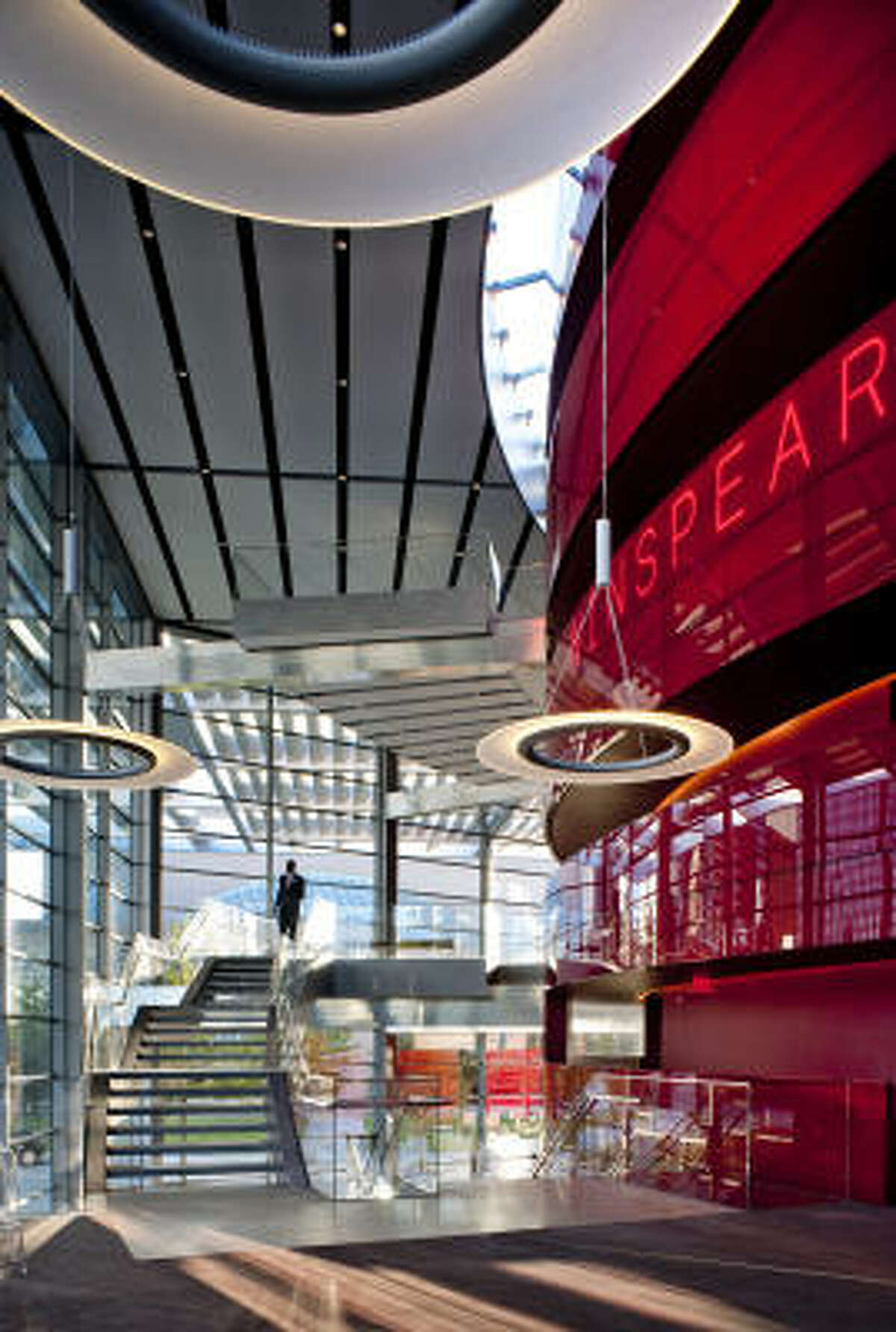 The stairs of the Margo and Bill Winspear Opera House appear to float around its central red core.