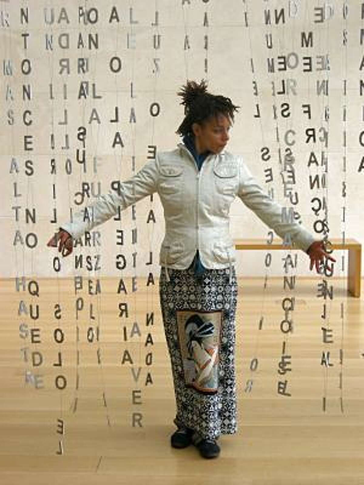 Cheray O'Neal of Los Angeles examines Jaume Plensa's 29 Poems, on exhibit at the Nasher Sculpture Center through May 16.
