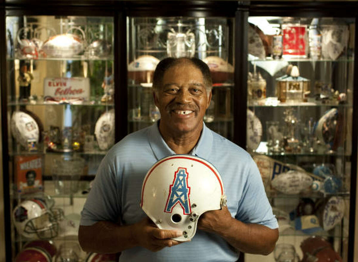 NFL Hall of Famer Elvin Bethea shows off some of his souvenirs and awards in his home. Bethea paid the price for all that hardware, though. He estimates he has had 25 operations related to his football career.