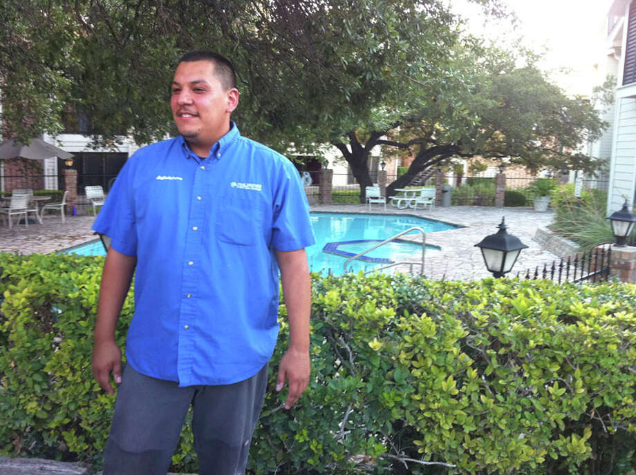 Cable repair technician Agustin Arreguin was about to check on his next job at Winding Creek Apartment Homes in the 13000 block of Northwest Military Highway, when he heard screams from the pool area and jumped over a gate to help a 7-year-old boy who was not breathing. Photo: Jessica Kwong