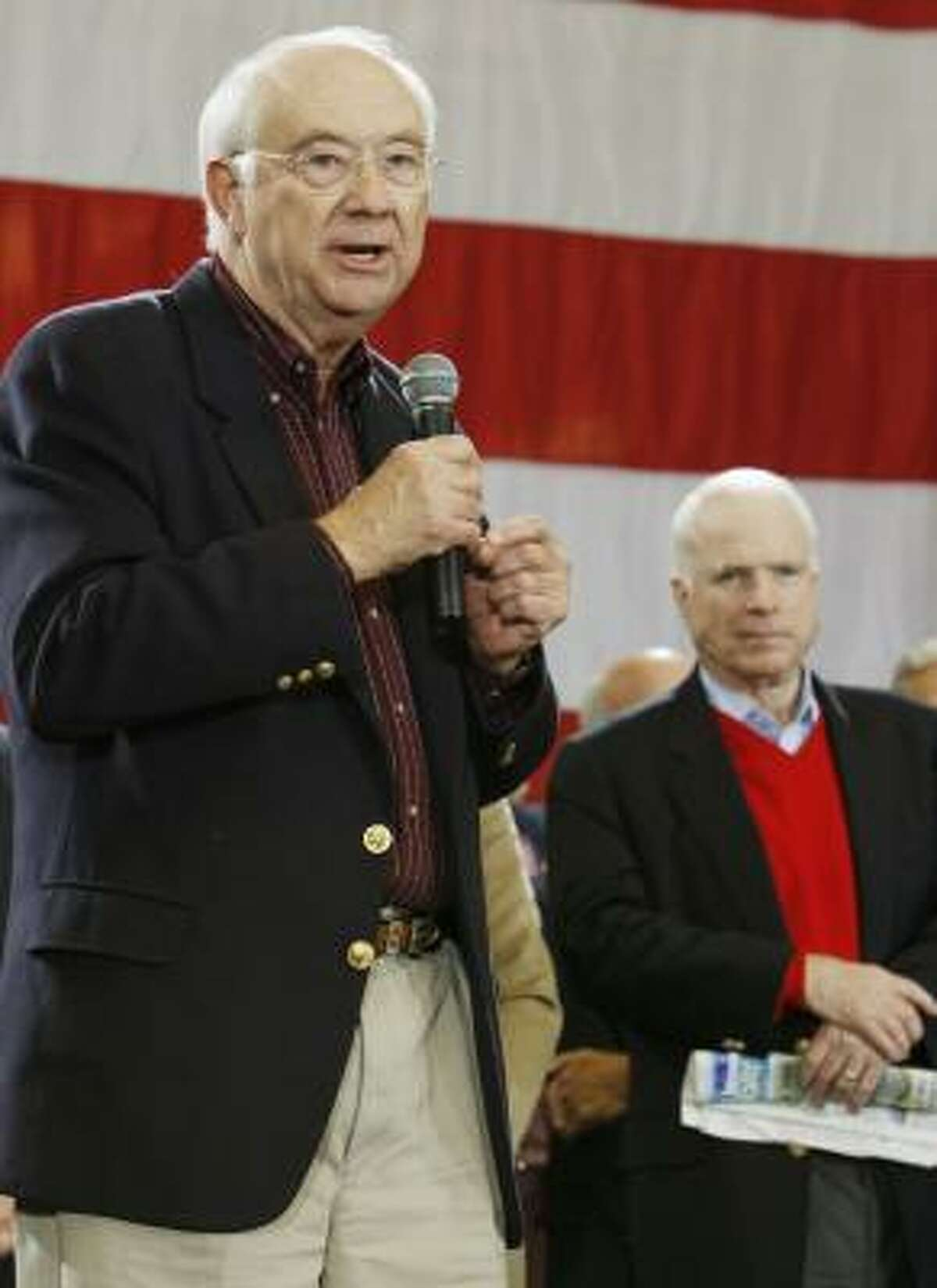 Former Texas Sen. Phil Gramm, left, was blasted by Sen. John McCain, right, for his comments on the economy.