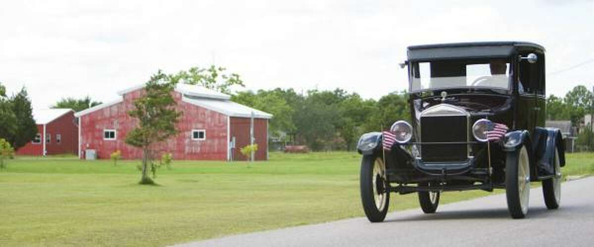 David Lucas, of Alvin, takes his 1927 Ford Model T on a jaunt through the Brazoria County countryside on Tuesday.