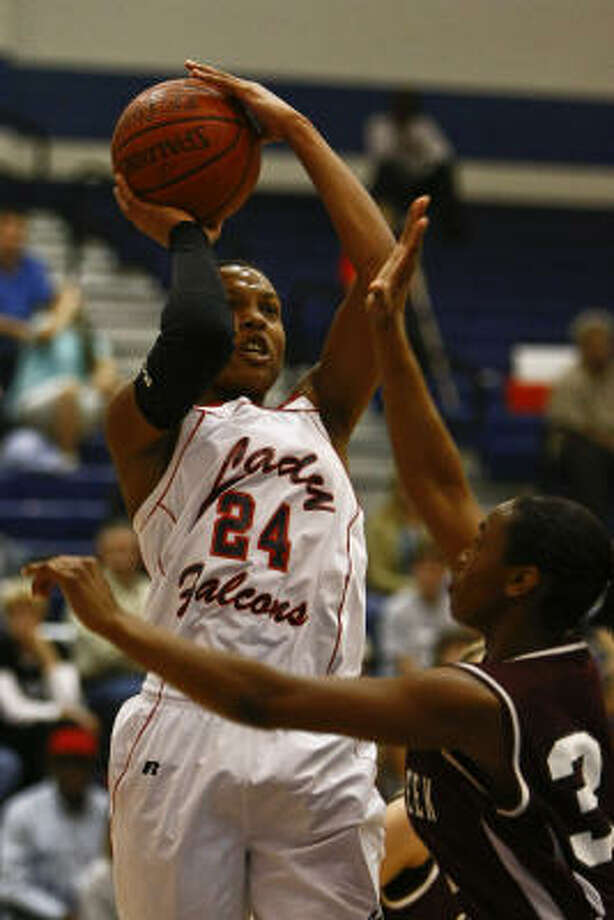 Clear Lake's Jasmine Beverly goes up for a shot over Clear Creek's Nyha Carter on Friday night. Photo: Michael Paulsen, Chronicle