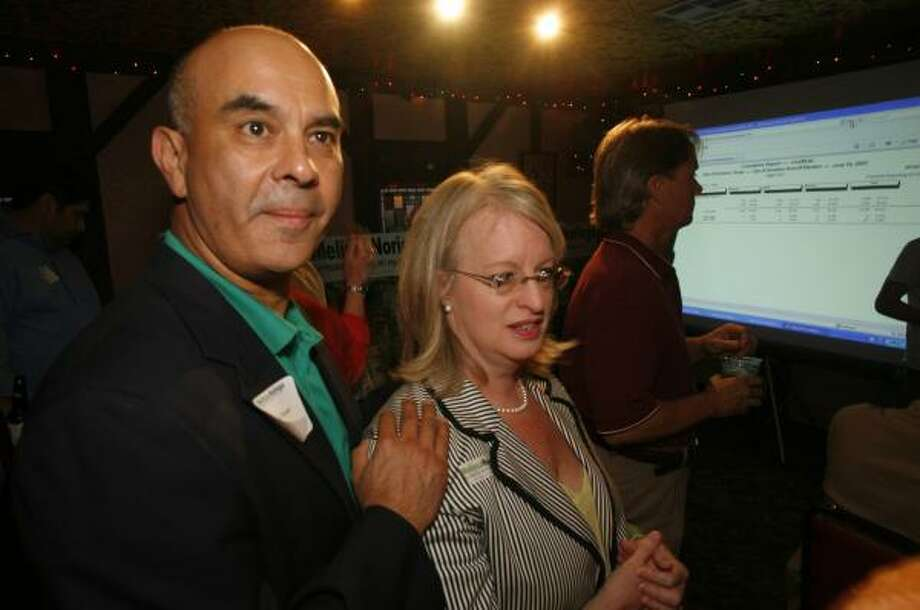 Melissa Noriega arrives with her husband, Rick Noriega, at her ballot-watch party Saturday. She won her runoff bid for the City Council At-Large Position 3 seat, vacated by Shelley Sekula-Gibbs. Photo: STEVE UECKERT, CHRONICLE