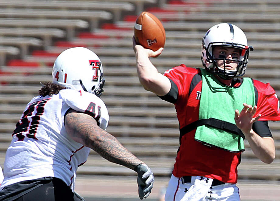 Texas Tech QB Seth Doege throws a pass while being pressured by Sam Fehoko during the Red Raiders' spring game. Doege will play behind an offensive line heavy on experience. Photo: Miranda Grubbs/Lubbock Avalanche-Journal / Lubbock Avalanche-Journal
