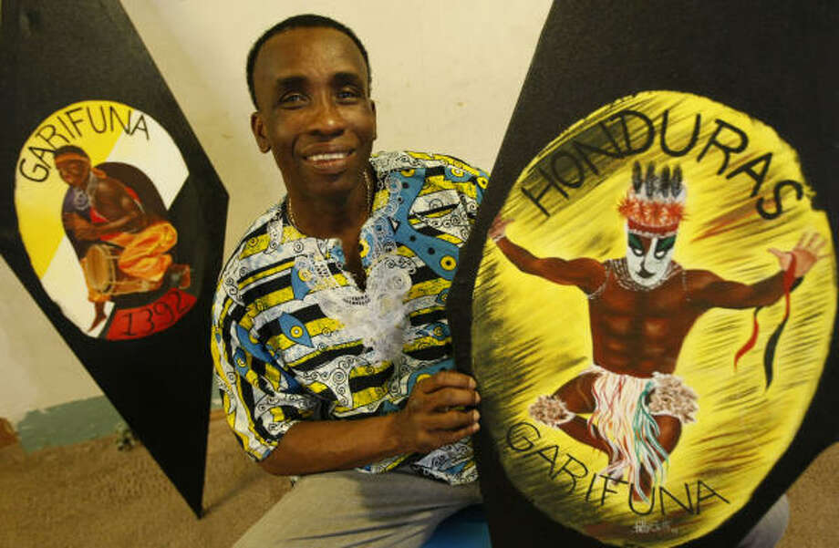 Santos Sambula, the president of Ballet Garifuna, shows some of the Honduran and Garifuna art in his home. The Garifuna people are an Afro-Caribbean group, and about 4,000 Garifunas from Honduras live in Houston. Photo: Julio Cortez, Chronicle