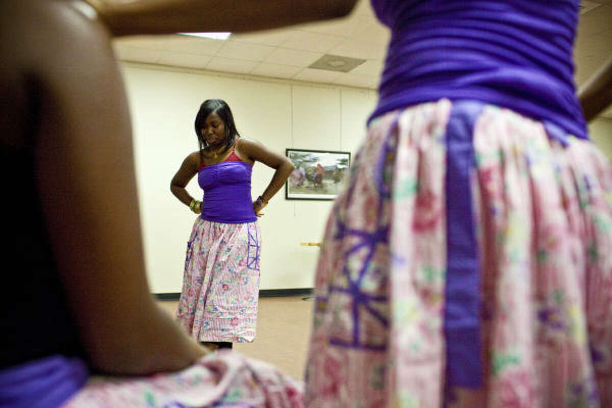 Dancer Gina Miranda, a member of Ballet Garifuna, goes over steps during a practice for an upcoming performance earlier this month at Talento Bilingue in Houston.