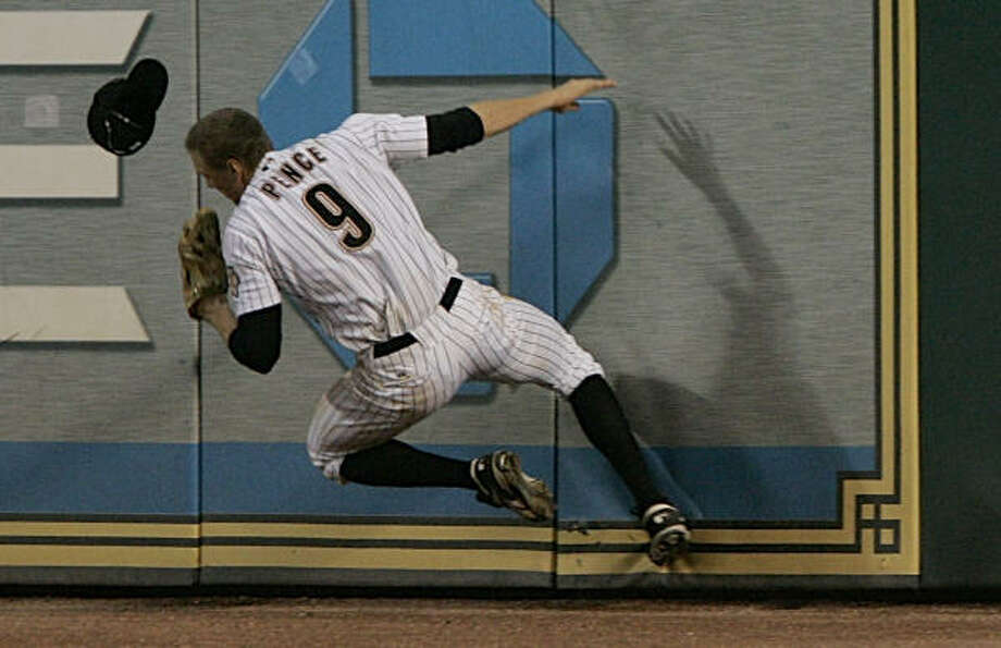 Hunter Pence bounces off the right field wall going after Rickie Weeks' two-run home run that tied up the game in the ninth inning. Photo: Pat Sullivan, AP