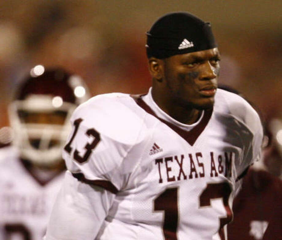 A&M tight end Martellus Bennett, showing his disgust during last week's loss to Oklahoma, has learned firsthand about the business side of big-time college football. Photo: Nick De La Torre, Chronicle