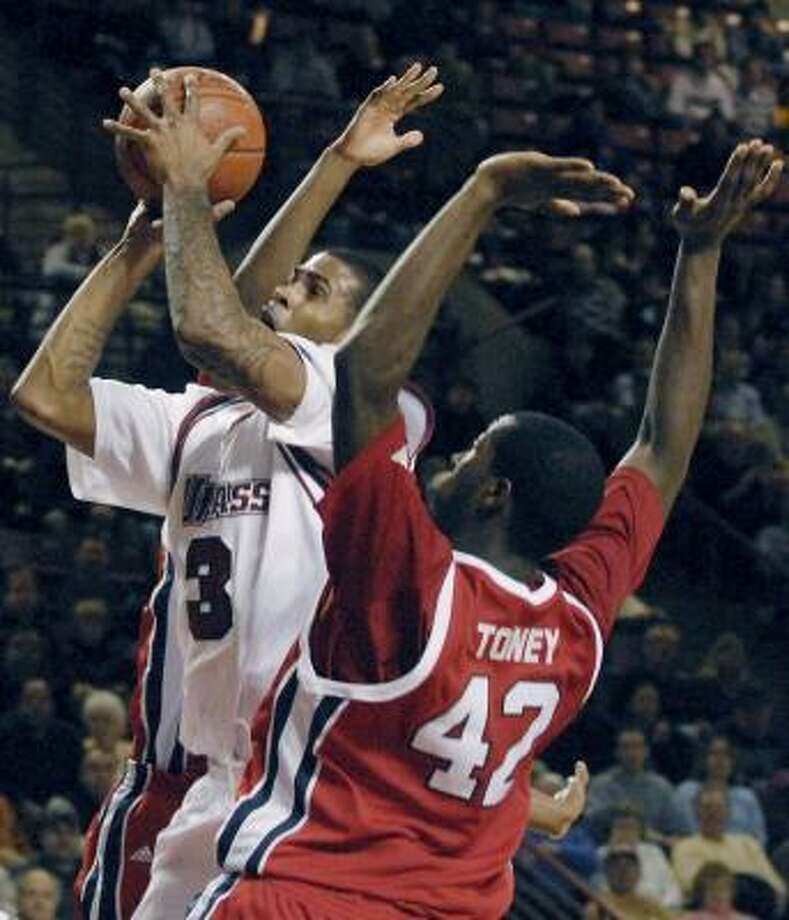 Gary Forbes, who led Massachusetts with 19 points, drives on Tafari Toney. Photo: NANCY PALMIERI, ASSOCIATED PRESS