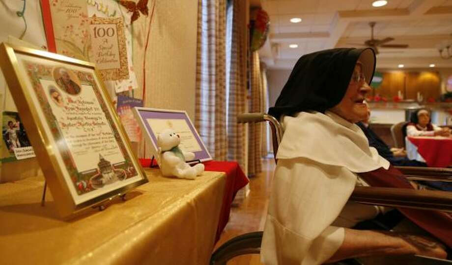 sister martha sebesta sits in her model t on tuesday beside displays of letters