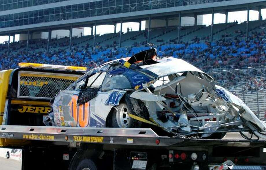Michael McDowell crashed during practice and was not hurt despite his car rolling several times. Photo: Larry Papke, AP