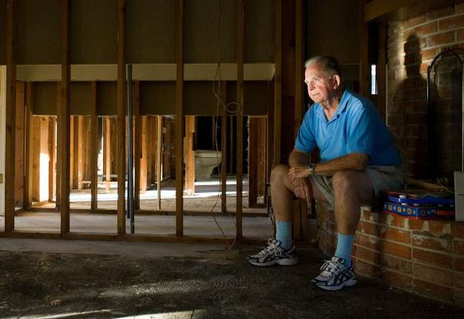 Brawley Marze sits in the shell of his Seabrook house, which has had all the carpeting, flooring and lower dry wall removed after flooding caused by Hurricane Ike. Photo: NICK De La TORRE, CHRONICLE