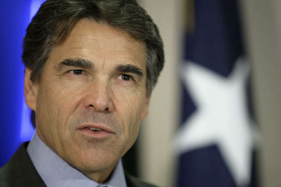Texas Gov. Rick Perry's campaign report shows he started this year with $6.6 million as he prepares for a possible battle with Hutchison for the Republican nomination for another term. Photo: David J. Phillip, AP