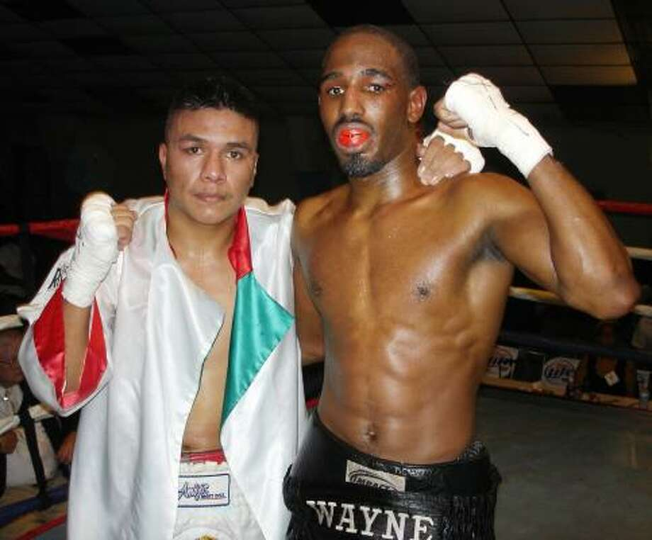 Benjamin Flores, left, defeated Wayne Fletcher by sic-round decision in this Oct. 28, 2005 bout in Houston. Flores, 25, died Tuesday at Parkland Memorial Hospital in Dallas of injuries sustained in a bout five days earlier. Photo: Michael Campbell, For The Chronicle