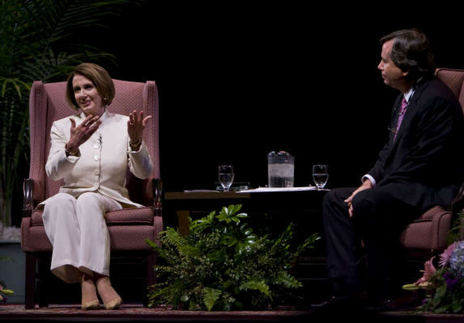 Speaker of the House Nancy Pelosi, with Progressive Forum President Randall Morton, discussed world affairs and her new book Friday night at the Wortham Center. Photo: James Nielsen, Chronicle