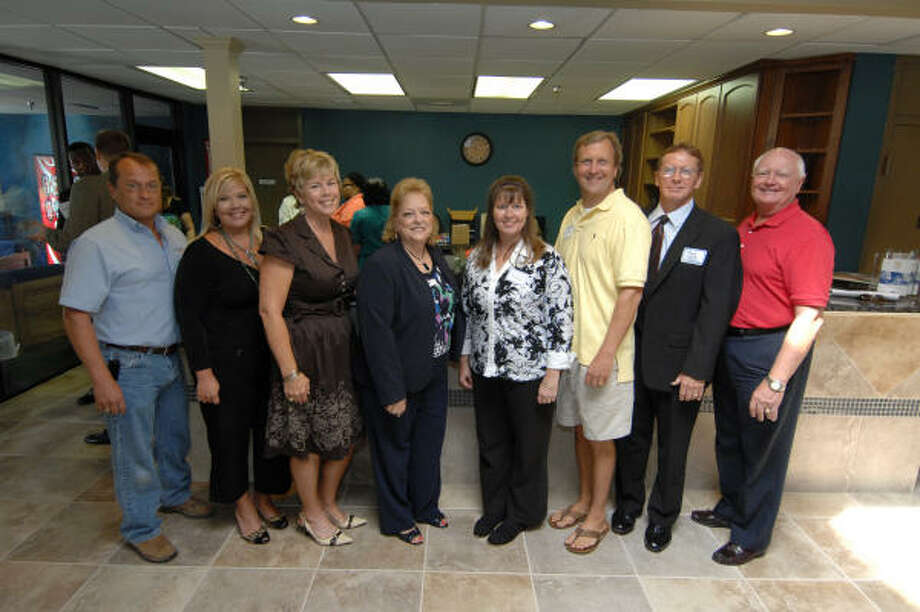 AT THE UNVEILING: (L to R) Wayne Greer, David Weekley Homes; Beth Avalos, Floors Inc.; Bette Moser, executive director for HomeAid Houston; Lisa Clark, president of the GHBA; Lorie Curtis, Newland Communities; Randy Bayer of Bayer Homes, Mark Welch, David Weekley Homes and Katy Mayor Don Elder Jr. help dedicate the lobby and reception area of the Krause Children's Center in Katy.