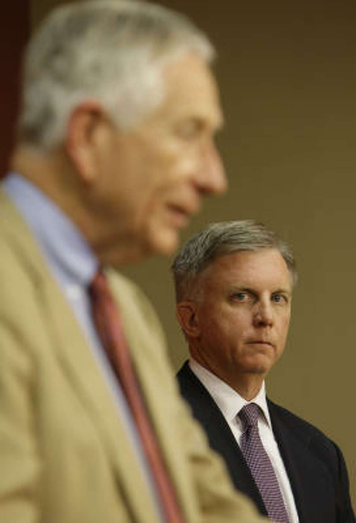 Astros owner Drayton McLane, left, has given a vote of confidence to general manager Ed Wade, right.