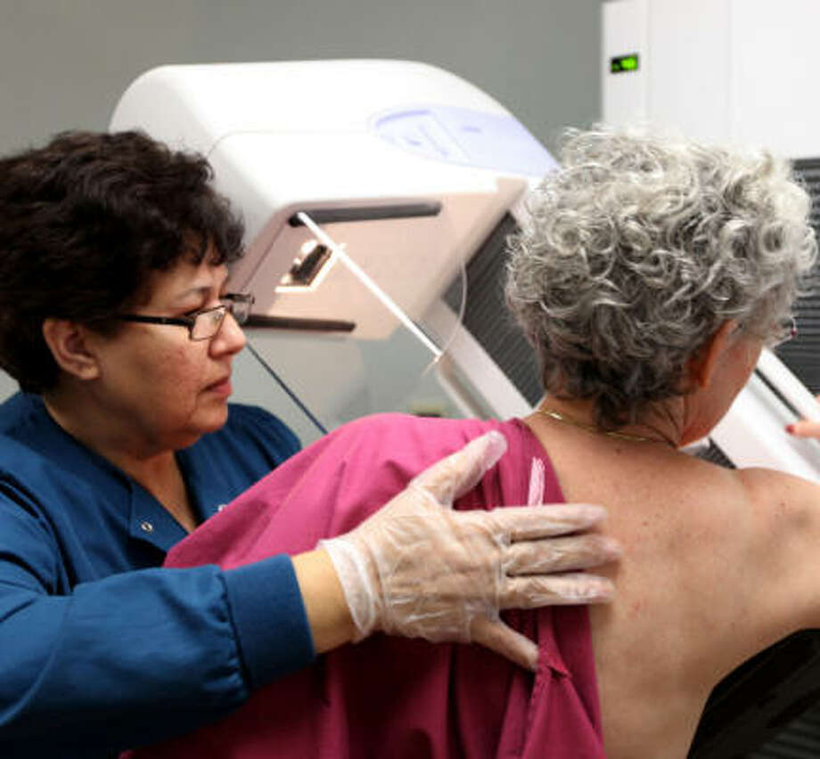 Blanca Rubio performs a mammogram on a 65-year-old patient at Evanston Hospital in Evanston, Ill., last month. Photo: Heather Charles, Chicago Tribune