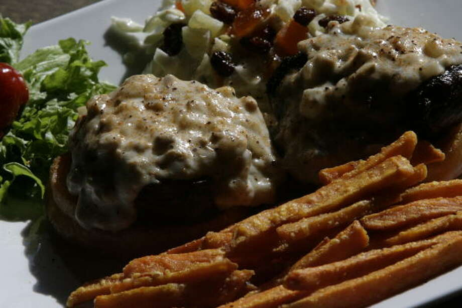 Peli Peli's, a South African eatery, two 4-ounce cuts of prime filet are served on deep-fried buns and covered with a rich mushroom wine sauce and is located on 110 Vintage Park Blvd. Photo: Billy Smith II, Chronicle