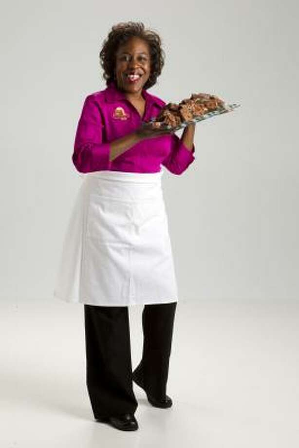 Self-taught baker Adria Carter is the owner of The Brownie Pan Fine Desserts and Gifts. Photo: Brett Coomer, Chronicle