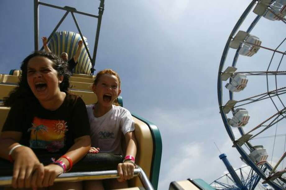 Rachel Adamo and her friend Christen Jackson scream as they feel weightlessness on the Pharaoh's Fury ride on the Kemah Boardwalk. Photo: Nick De La Torre, Houston Chronicle