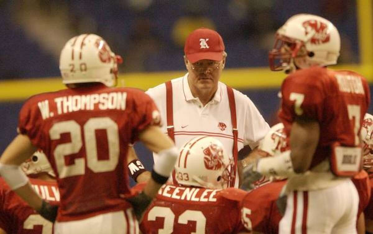 There may be several differences in coaching at private school Houston Christian, left, compared to public powerhouse Katy, but the basic element for Mike Johnston remains trying to impart his football wisdom on impressionable young players.